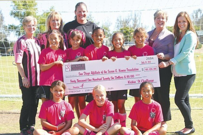 Tournament founder Pam Bickel, second from left, and her committee with their donation to the San Diego affiliate of the Susan G. Komen Foundation at the 2013 tournament.