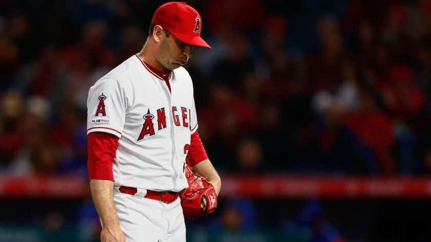 ANAHEIM, CALIF. - APRIL 04: Los Angeles Angels starting pitcher Matt Harvey (33) walks back to the d