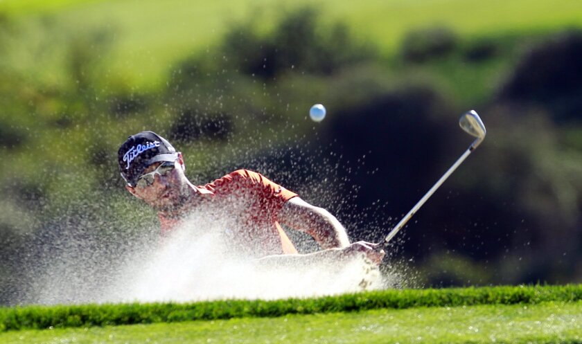 Leader Kyle Stanley hits out of the sand on the 14th hole of Torrey Pines south during the 3rd round of the Farmers Insurance Open on Saturday, Jan. 28, 2012.