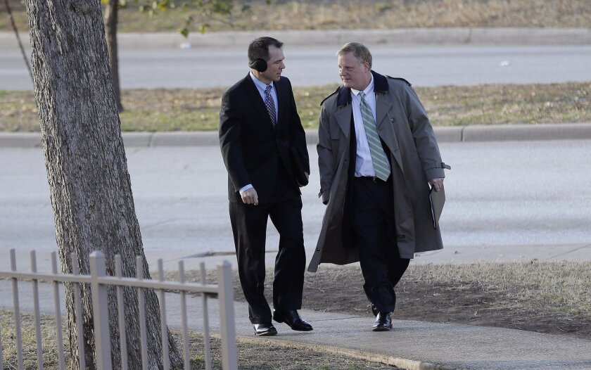 File - In the Feb. 12, 2014 file photo, Victor Holmes, left, and partner Mark Phariss, right, arrive at the U.S. Federal Courthouse, in San Antonio, where a federal judge is expected to hear arguments in a lawsuit challenging Texas' ban on same-sex marriage. Republican attorneys general across the