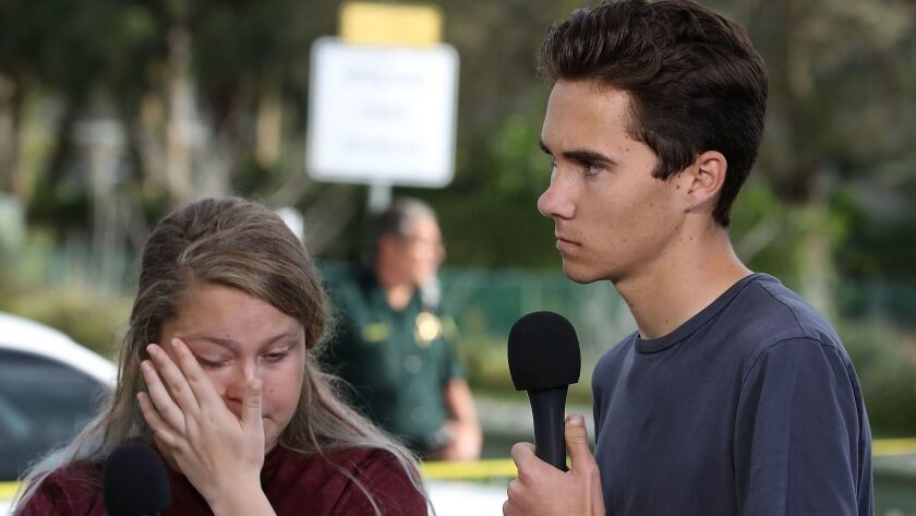 Students Kelsey Friend, left, and David Hogg speak about the mass shooting at Marjory Stoneman Douglas High School on Feb. 15, 2018.