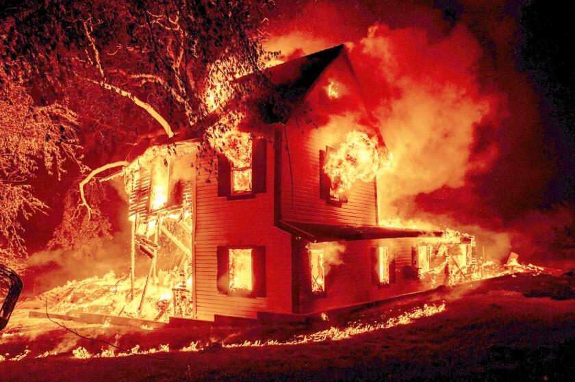 A home burns amid the Dixie fire
