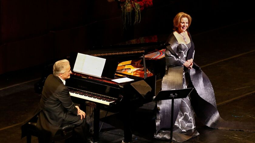 Renée Fleming, onstage with pianist Hartmut Höll on Tuesday night at the Dorothy Chandler Pavilion.