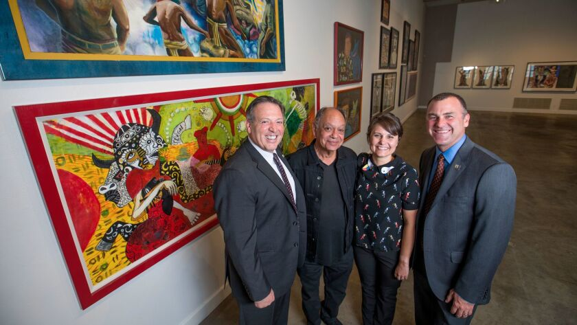 Riverside City Manager John Russo, left, actor and collector Cheech Marin, Riverside Art Museum Exec