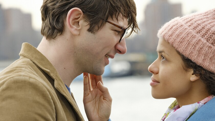 "(L-R) - Michiel Huisman and Gugu Mbatha-Raw in a scene from ""Irreplaceable You."" Credit: Linda Kalle"