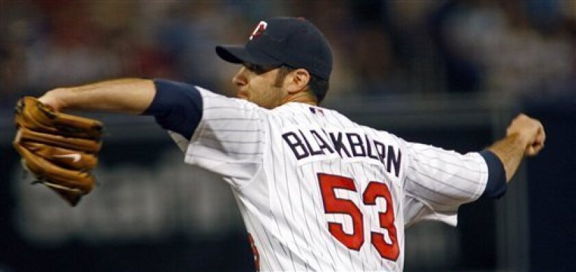 Minnesota Twins' Nick Blackburn pitches against the Chicago White Sox in the first inning of a baseball game Friday, July 10, 2009 in Minneapolis. (AP Photo/The Star Tribune, Marlin Levison)