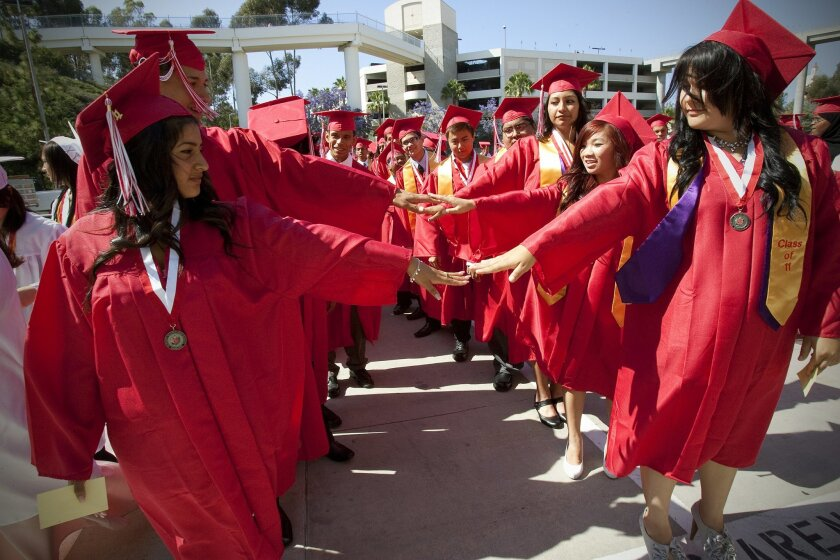 At Hoover High School's graduation held on campus at SDSU, Viejas Arena, students line up before the start of the entrance march into the arena.
