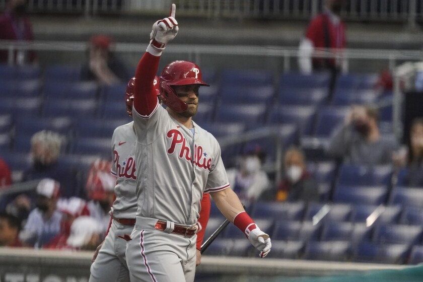 Philadelphia Phillies' Bryce Harper celebrates his solo home run during the first inning of a baseball game against the Washington Nationals at Nationals Park, Tuesday, May 11, 2021, in Washington. (AP Photo/Alex Brandon)