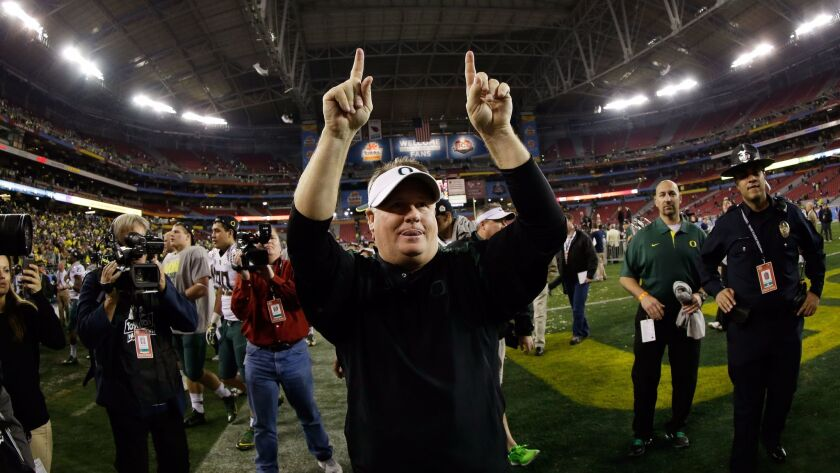 Then-Oregon head coach Chip Kelly celebrates after the Ducks beat the Kansas State Wildcats, 35-17, in the Tostitos Fiesta Bowl at University of Phoenix Stadium on Jan. 3, 2013.