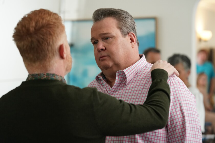 """Jesse Tyler Ferguson, left, and Eric Stonestreet in the series finale of """"Modern Family"""" on ABC."""