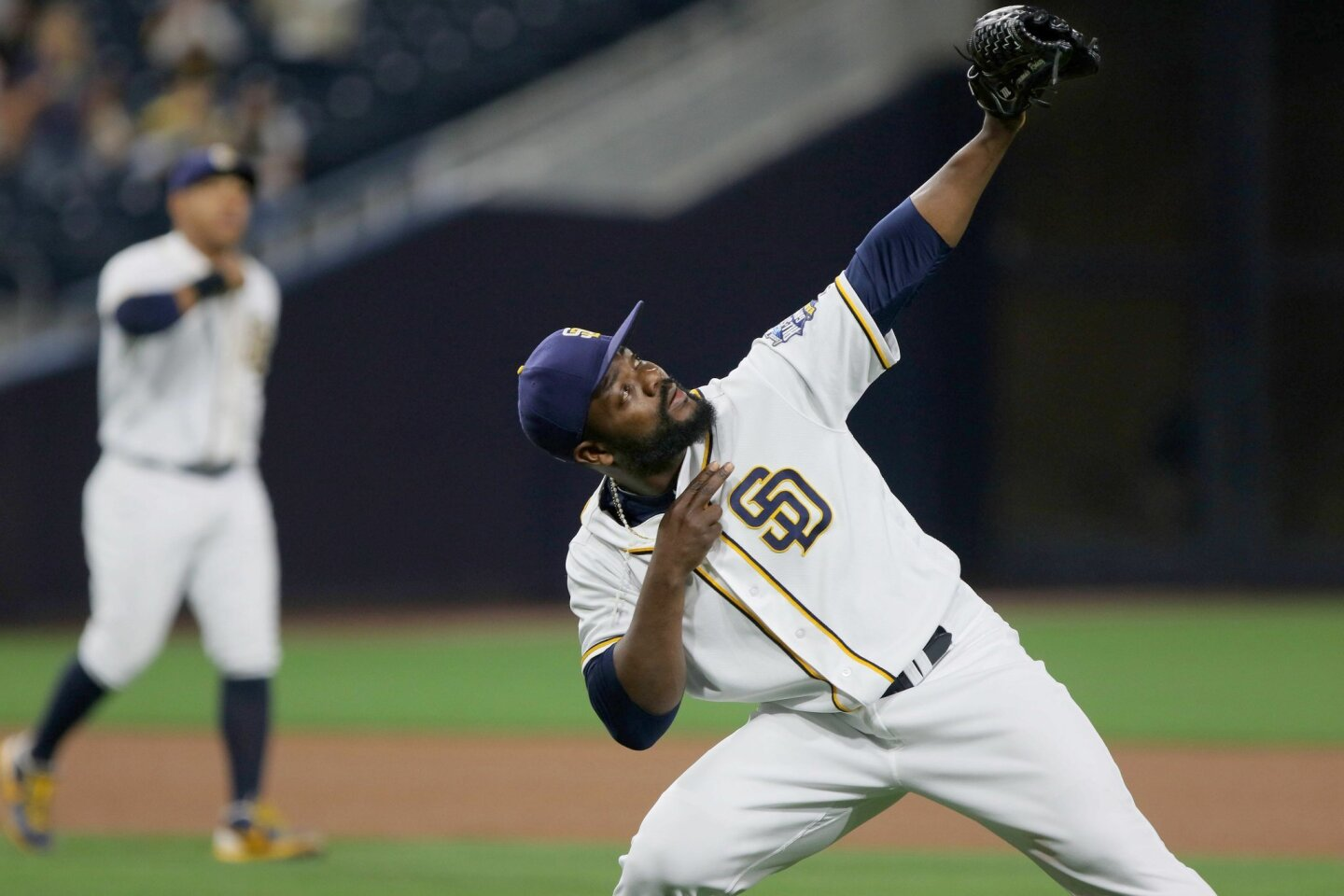 Padres' closer Fernando Rodney gestures to the sky after the Rockies final batter Trevor Story flies out.