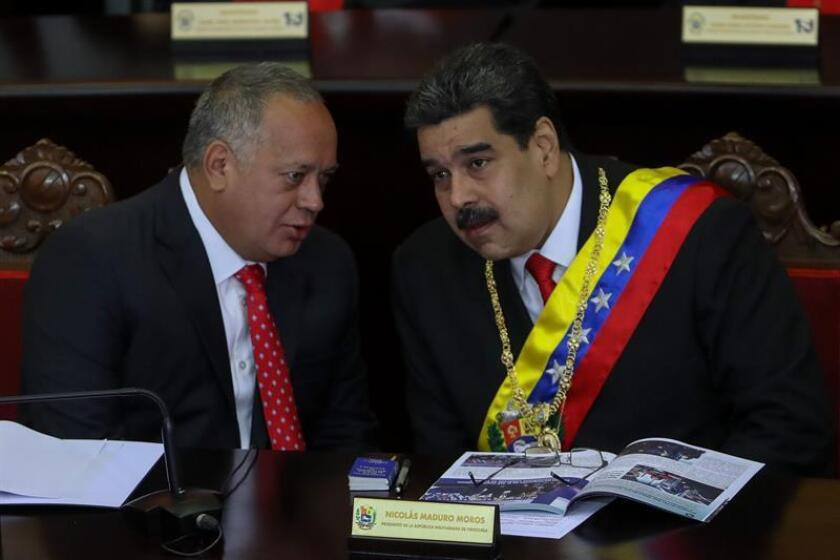 Photo taken Jan. 24, 2019, in Caracas, showing the head of Venezuela's government-supporting National Constituent Assembly, Diosdado Cabello(l), speaking with elected President Nicolas Maduro at a ceremony opening the yearly session of the country's Supreme Court. EFE-EPA/Cristian Hernandez