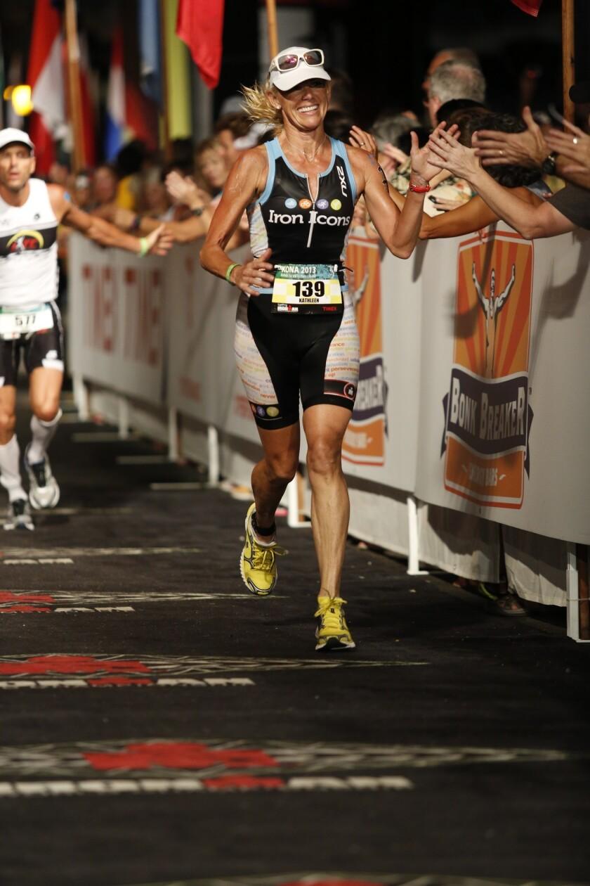 Kathleen McCartney finishes the 2013 Ironman edition.