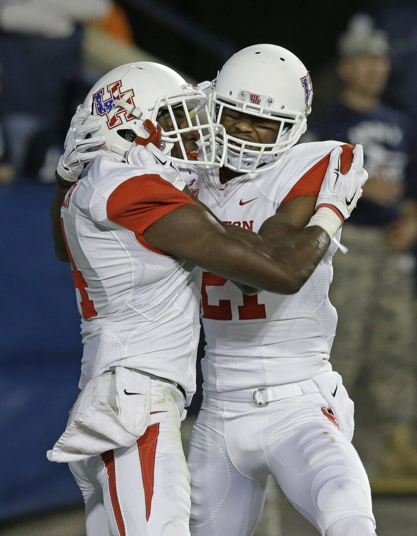 Houston wide receiver Daniel Spencer (4) celebrates Houston wide receiver Markeith Ambles (21) after scoring against BYU in the second quarter of an NCAA college football game Thursday, Sept. 11, 2014, in Provo, Utah.(AP Photo/Rick Bowmer)