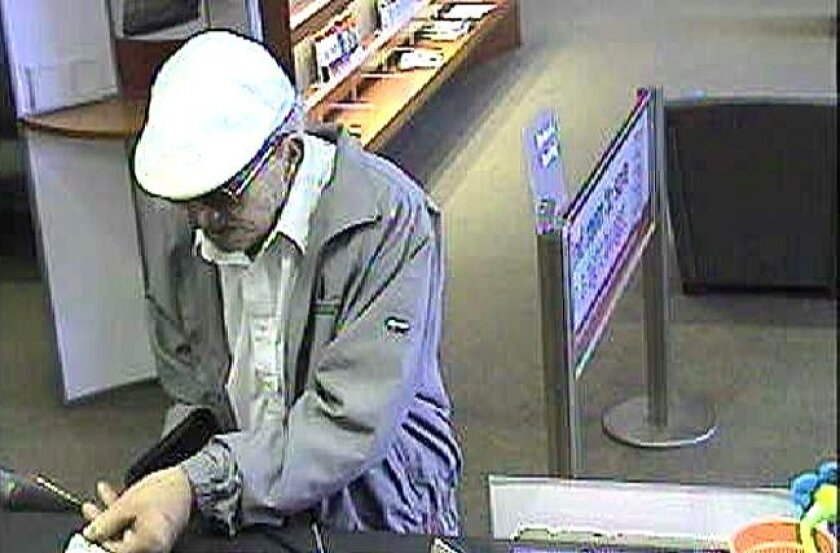 "The suspect in the ""geezer bandit"" string of robberies is seen Thursday, June 24, at a Bank of America in Temecula."