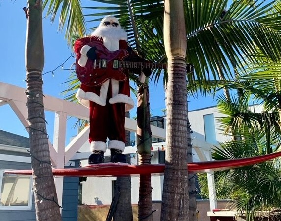 A surf rockin' Santa is spotted along Nautilus Street as he prepares for another sunny La Jolla Christmas.