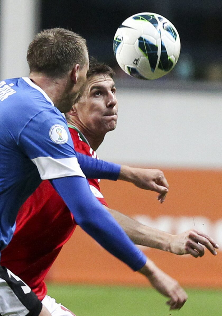 FILE - In this Friday, Oct. 12, 2012 filer, Hungary's Zoltan Gera, right, vies for the ball with Estonia's Taavi Rahn during a World Cup 2014 Group  qualification match between Estonia Hungary national teams in Tallinn, Estonia. (AP Photo/Liis Treimann, File)