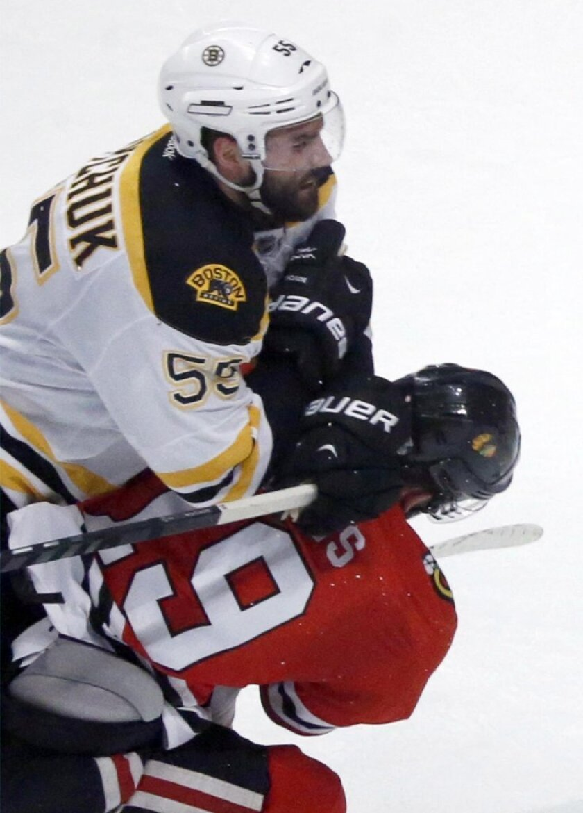 Hits to the head, such as this one from the recent NHL Finals, were outlawed prior to the 2011-12 season. Despite the ban, concussions have increased.