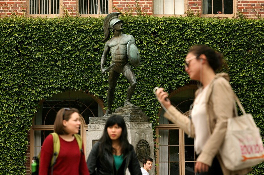An anonymous couple are donating $20 million to help fund USC scholarships. Above, people at the USC campus.