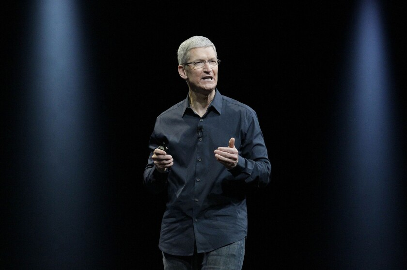 Apple Chief Executive Tim Cook is resisting a federal judge's order that Apple build software to unlock an iPhone used by one of the San Bernardino terrorist attackers. Above, Cook speaks in 2014.