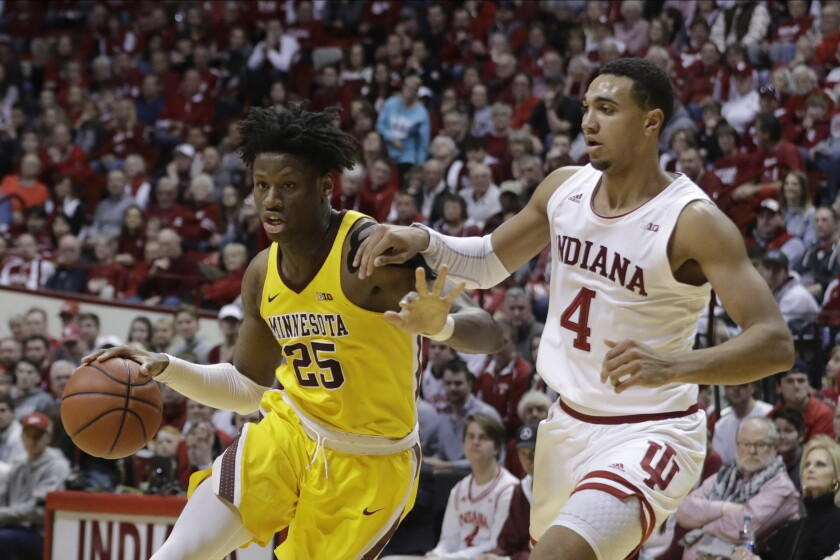 Minnesota center Daniel Oturu drives to the basket against Indiana's Trayce Jackson-Davis during a college game in March.