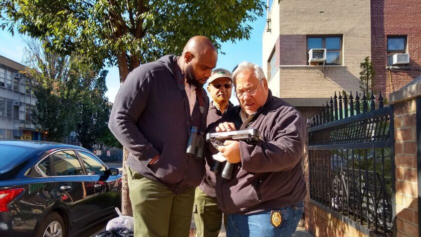"""Ground surveyors Mohsen Abdelaziz, right, and Amir Ahmed, center, strategize with supervisor Antony Massop about how to get access to a """"refusal"""" property in the Bedford-Stuyvesant section of Brooklyn."""