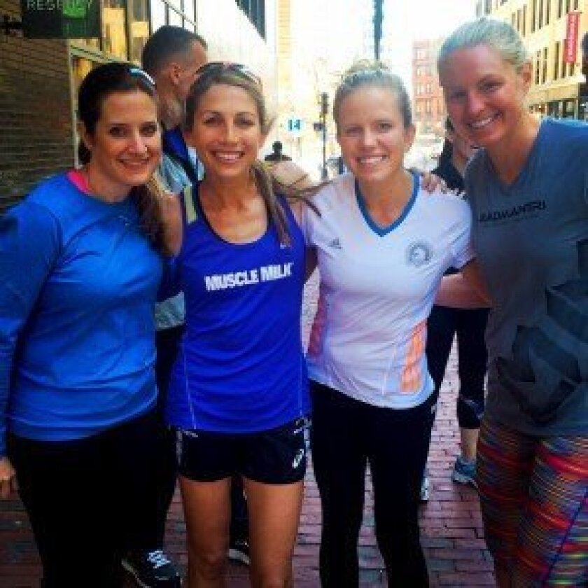Jessica Sebor, second from right, with friends at the Boston Marathon.