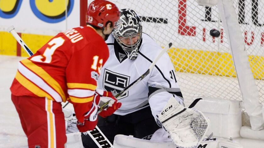 Kings goalie Ben Bishop, right, gives up a goal to Calgary Flames' Johnny Gaudreau during the second period Sunday.