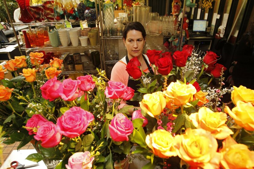 Nicole Maranda prepares roses  for Valentine's Day at  Adelaide's flower shop in La Jolla.