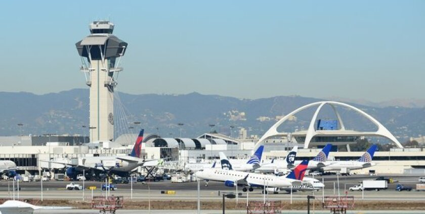 A former baggage handler for Delta Air Lines at Los Angeles International Airport was sentenced to one year in prison for his role in a drug-smuggling operation.