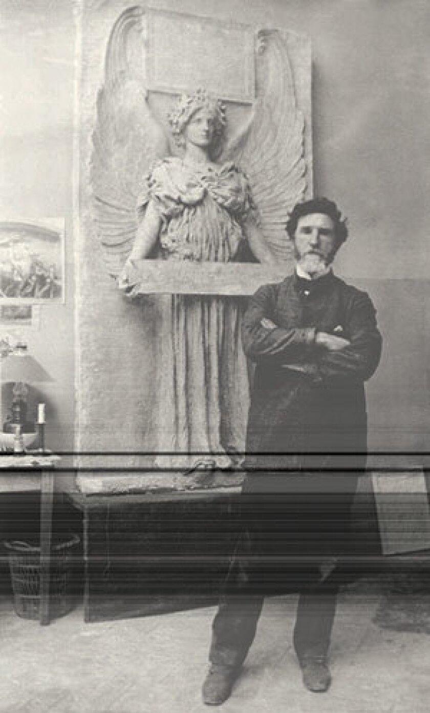"""Augustus Saint-Gaudens in his Paris studio, with a variation of his """"Amor Caritas."""""""