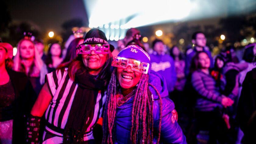 Maria De Leon, left, and Debra Randall celebrate New Year's Eve at Grand Park.