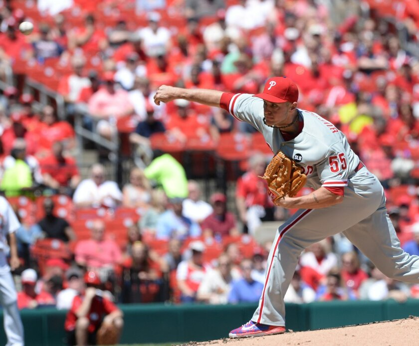 Philidelphia Phillies' starting pitcher David Buchanan (55) throws against the St. Louis Cardinals in the first inning in a baseball game, Thursday, April 30, 2015, at Busch Stadium in St. Louis. (AP Photo/Bill Boyce)