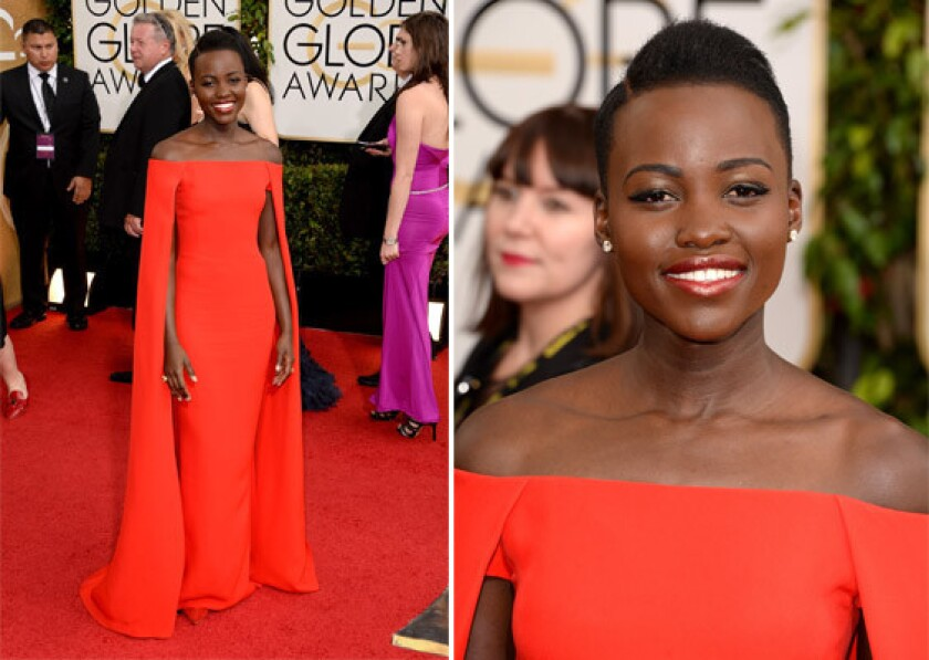 Actress Lupita Nyong'o in a red cape dress by Ralph Lauren at Sunday's Golden Globes.