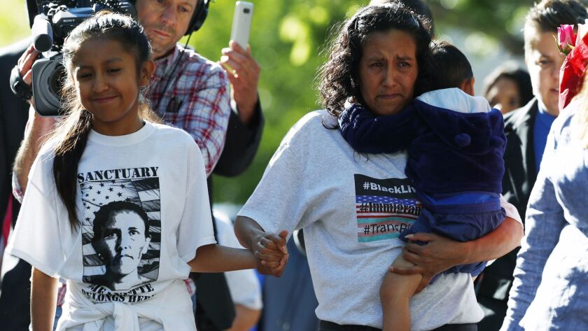 Jeanette Vizguerra, center, a Mexican immigrant who has lived in a church to avoid immigration autho
