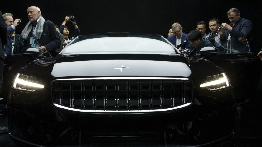 Attendees look at the the Polestar 1 during its unveiling in Shanghai, China Tuesday Oct. 17, 2017.