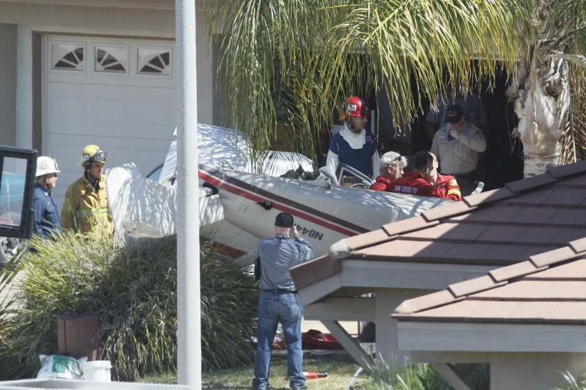 The aftermath of the crash of a small plane on a cul-de-sac in Santee near the Gillespie Field airport on Sept. 3.