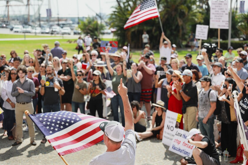 Demonstrators against mask and vaccine mandates listened to speakers during a San Diego Young Republicans rally