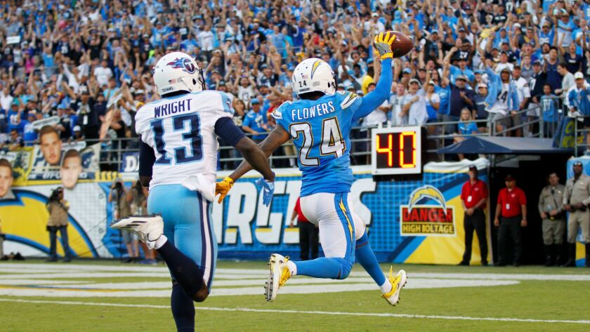 San Diego Chargers Brandon Flowers runs in an interception for a touchdown in the 4th quarter as Tennessee Titans Kendall Wright trails at Qualcomm Stadium on Nov. 6, 2016. Photo by K.C. Alfred/The San Diego Union-Tribune