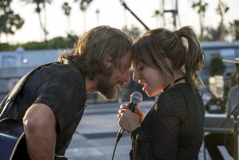 This image released by Warner Bros. shows Bradley Cooper, left, and Lady Gaga in a scene from the la