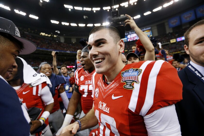 Mississippi quarterback Chad Kelly (10) celebrates after their victory over Oklahoma State in the Sugar Bowl college football game in New Orleans, Friday, Jan. 1, 2016. Mississippi won 48-20. (AP Photo/Jonathan Bachman)