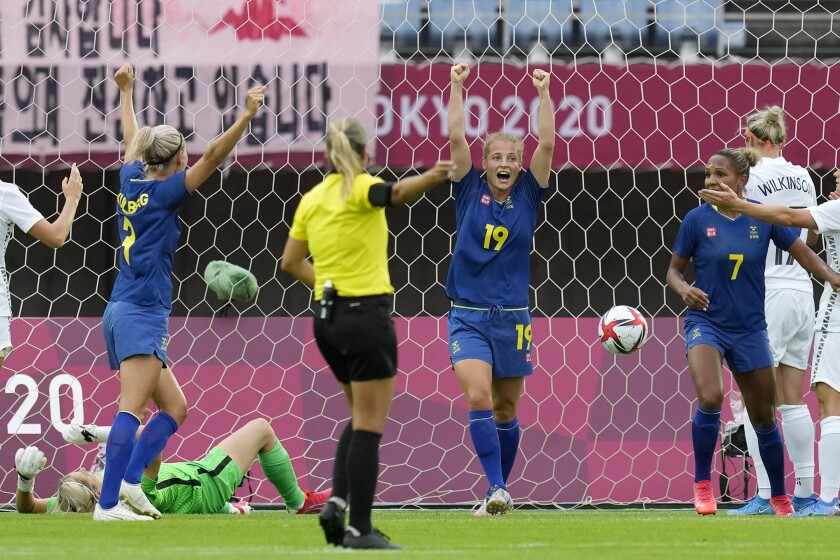 Sweden's Anna Anvegard (19) celebrates after scoring on a header against New Zealand during a women's soccer match between New Zealand and Sweden at the 2020 Summer Olympics, Tuesday, July 27, 2021, in Rifu, Japan. (AP Photo/Andre Penner)