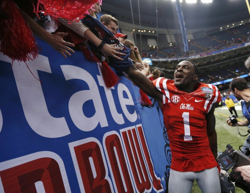 Mississippi wide receiver Laquon Treadwell (1) reacts with fans after their ivory over Oklahoma State in the Sugar Bowl college football game in New Orleans, Friday, Jan. 1, 2016. Mississippi won 48-20. (AP Photo/Jonathan Bachman)