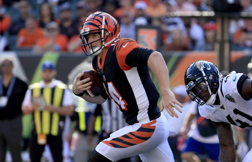 Cincinnati Bengals quarterback Andy Dalton runs with the ball against the Jacksonville Jaguars on Oct. 20.