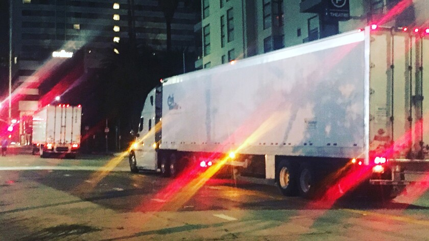 On Hollywood Boulevard, 4:45 a.m., two 18-wheel trucks containing cargo from pieces of the 'Hamilton