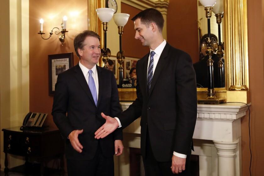 Sen. Tom Cotton shakes hands Brett Kavanaugh on Capitol Hill in August.