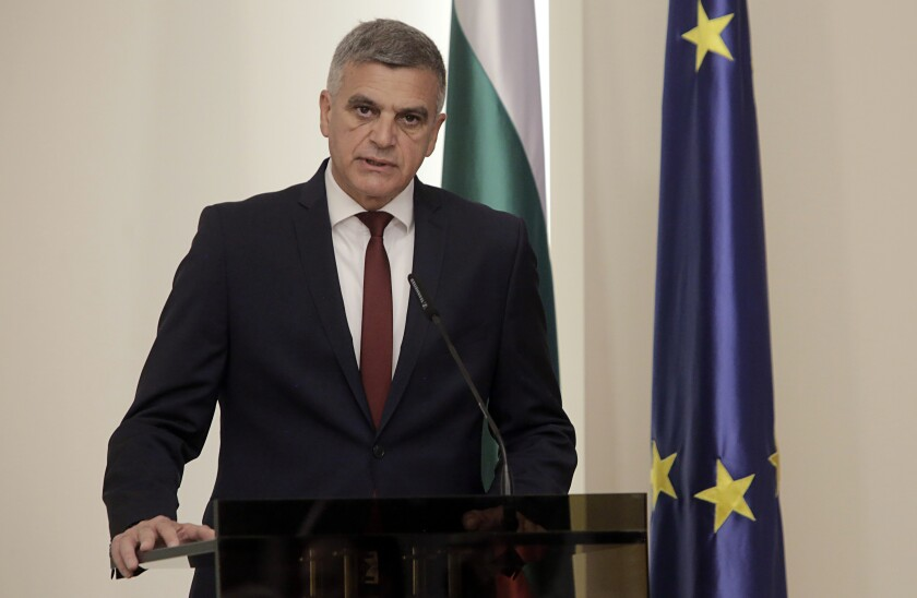 """FILE - In this May 12, 2021 file photo, Bulgarian Interim PM Stefan Yanev attends a press conference in Sofia. Bulgaria's interim prime minister called for a consolidation of national efforts to eradicate endemic graft. Yanev spoke at a meeting of the government security council he convened on Monday, June 7 to discuss new anti-corruption policies following the sanctions by the U.S. government on Bulgarian public officials and businessmen for their allegedly """"extensive"""" roles in corruption. (AP Photo/Valentina Petrova, file)"""