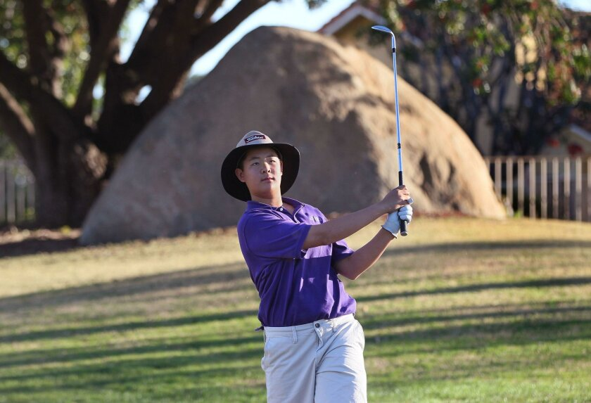Alexander Yang hits from the sand trap on hole 10 at the Shadowridge Country Club golf course in Vista.