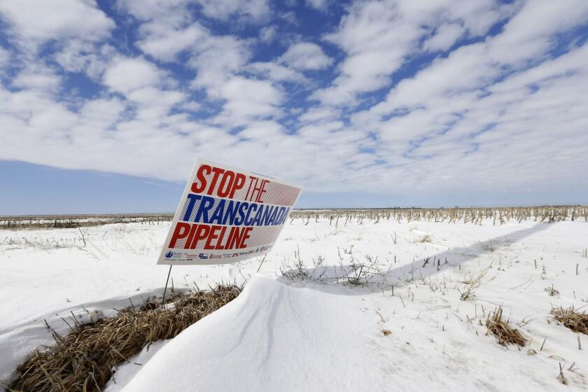 A sign opposing the Keystone XL pipeline appears in a field near Bradshaw, Neb.