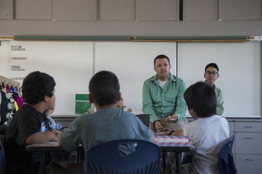 4th grade teacher Michael Bruder, left, introduces student teacher Michael Wong to his 4th grade class during the first day of class at Hilltop Drive Elementary School during the first day of class. September 8, 2015. Photo by David Hodges.